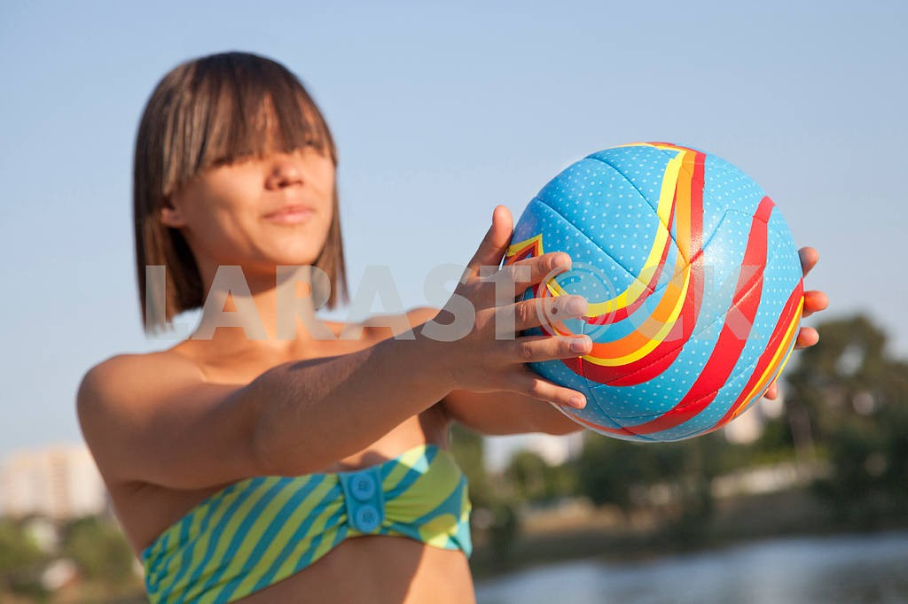 Young beautiful lady is holding volleyball ball — Image 9556