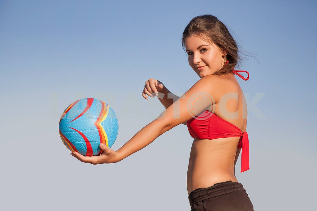Young beautiful lady is holding volleyball ball — Image 9559