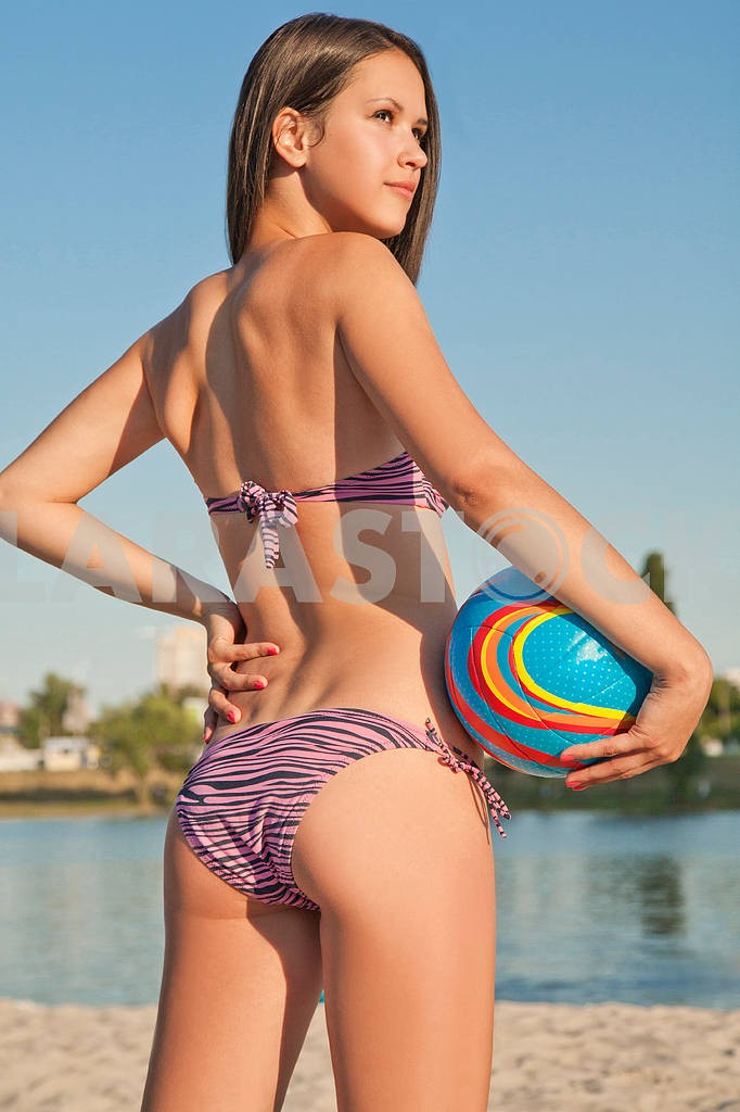 Young beautiful lady is holding volleyball ball — Image 9562
