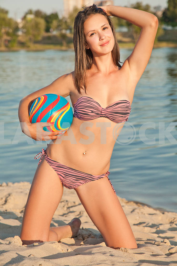 Young beautiful lady is holding volleyball ball — Image 9563