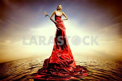 Beautiful girl standing on water