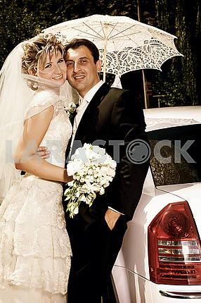 Newlyweds under umbrella