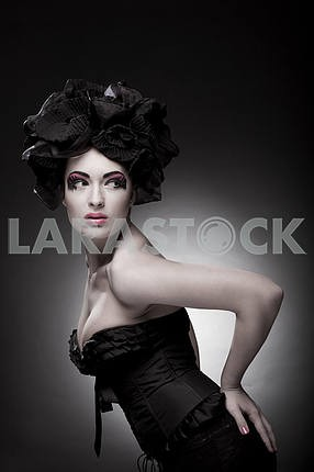 Closeup portrait of a beautiful young woman. Fashion art photo