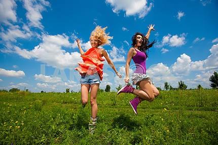 Two girlfriends having fun in field